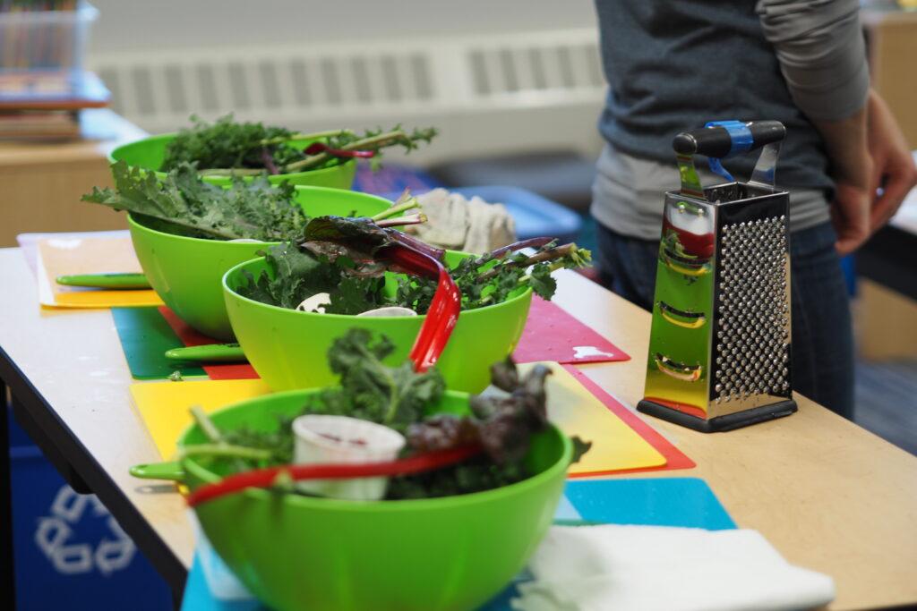 Four bowls of kale salad