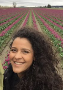 Elaine in a field of flowers