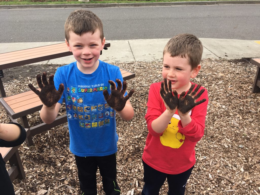 Two boys with dirty hands