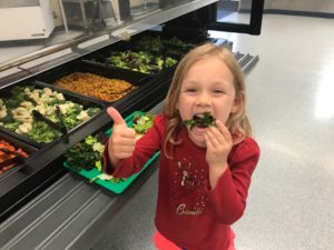 Carl Cozier student gives a happy thumbs-up for kale
