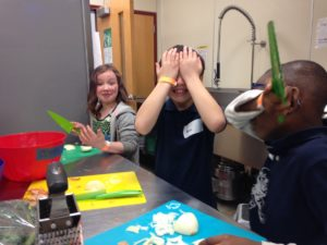 Kids Dayz student chefs practicing knife skills