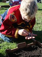 Common Threads student examining soil