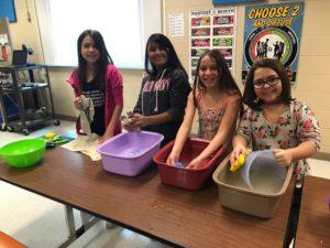 Student dishwashing team